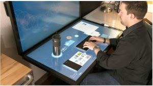 Ideum experiments with tangible interface on projected capacitive touch tables